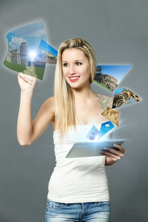 conceptual photo of woman booking her holidays with a touch screen device photo