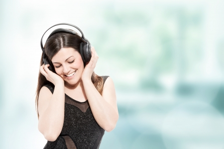 beautiful brunette woman with headphones listen to music photo