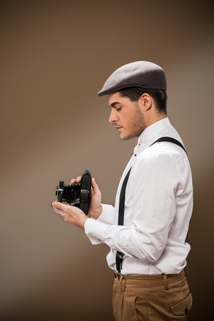 photo of photographer of the 30s with old dslr camera photo