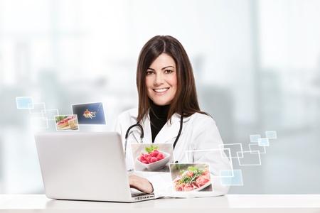 conceptual photo of a female nutritionist Standard-Bild
