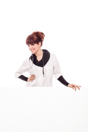 Photo of brunette doctor with white messageboard - isolated photo