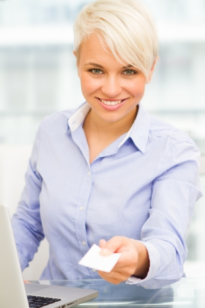 businesscard: businesswoman is giving her businesscard while smiling