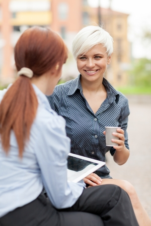 two businesswoman having a conversation Stock Photo