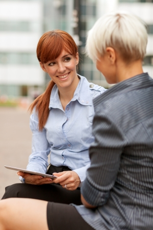 two businesswoman having a conversation photo