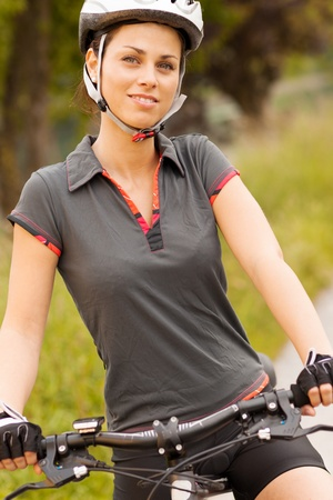 Portrait of woman with mountain bike photo