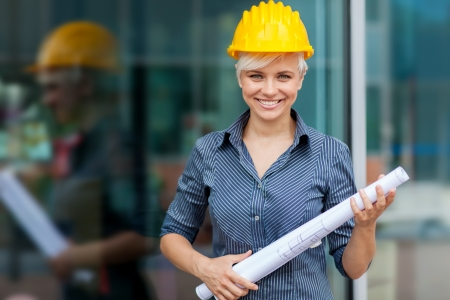 female architect: photo of female constructor with blueprints