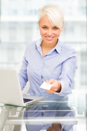 businesscard: Photo of businesswoman is giving her businesscard while smiling Stock Photo