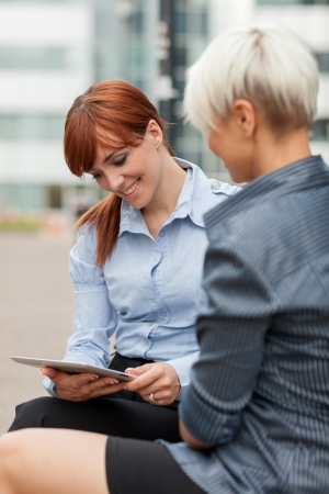 photo of two businesswoman having a conversation photo