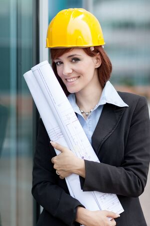female construction worker: photo of female constructor with blueprints
