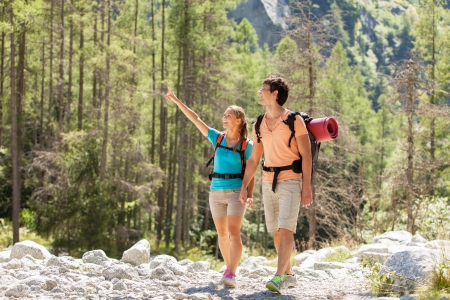 Young couple is doing trekking in the mountains photo