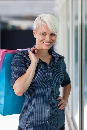 Attractive blonde woman with shopping bags Stock Photo - 21826915