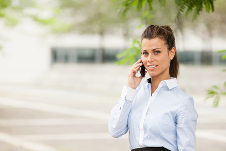Brunette businesswoman who is phoning Stock Photo - 22202709