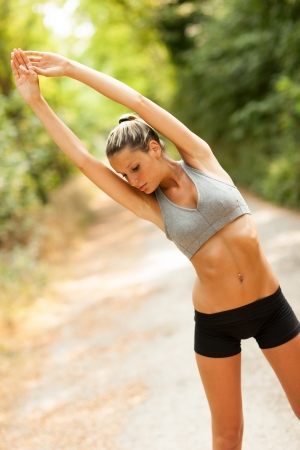 Young sexy blonde woman is doing stretching exercises  photo