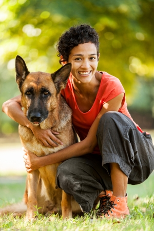 sitter: Image of woman with a german shepherd in a grass field
