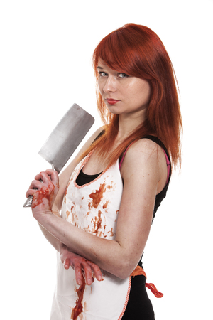 young knife: Red hair female buttcher with knife and blood on apron Stock Photo