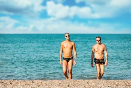 Photo of attractive gay couple at the beach  Stok Fotoğraf