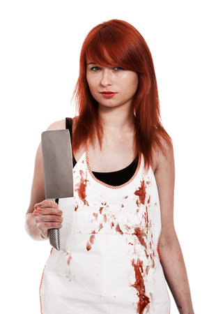 Red hair female buttcher with knife and blood on apron photo