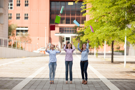 passed: Conceptual photo of students throwing their books in the air Stock Photo