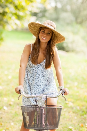 Photo of a beautiful girl cycling in a park  photo