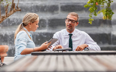 Photo of businessman on wheelchair talks to his colleague Stock Photo - 24146971