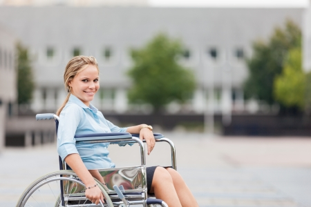Photo of smiling businesswoman on wheelchair