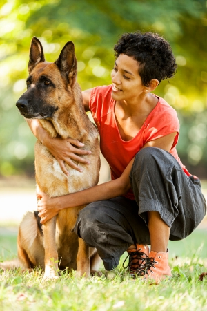 Photo of woman with a german shepherd in a grass field Stock Photo - 24147099