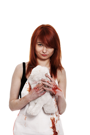 Red hair female buttcher with knife and blood on apron Stock Photo