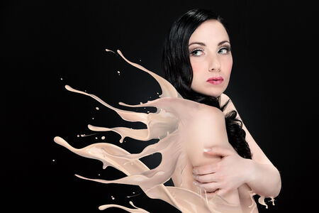 Woman is melting into a liquid  photo