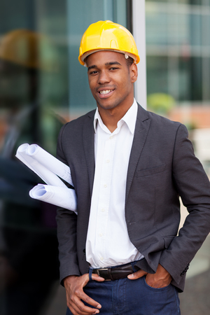 hat project: photo of construction engineer with blueprints Stock Photo