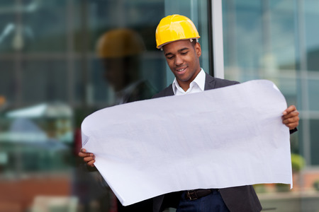 engineering: photo of construction engineer with blueprints Stock Photo