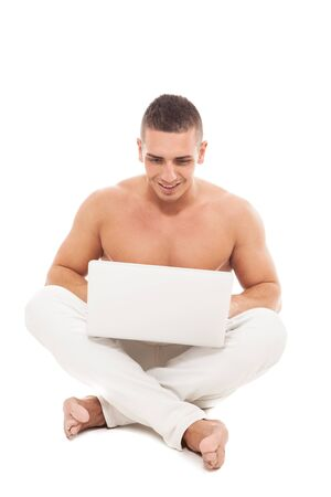nacked: Photo of caucasian man with nacked chest working with notebook while smiling over white isolated background