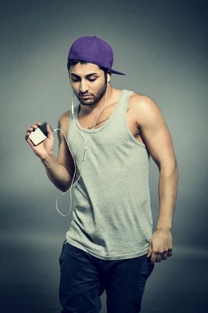 portable mp3 player: Photo of casual man with mp3 player
