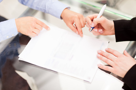 law office: Business partner are signing the contract Stock Photo