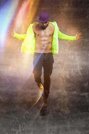 nacked: Photo of jumping dancer with nacked chest