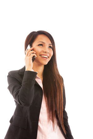 Portrait of asian businesswoman smiling while phoning over white isolated background