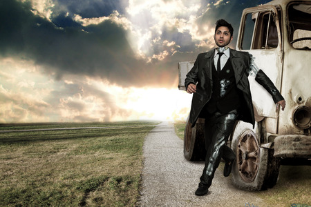 steely: Robot businessman over landscape background Stock Photo