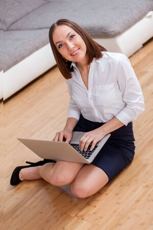working from home: Smiling caucasian businesswoman working from home Stock Photo