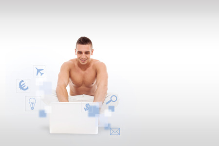nacked: Caucasian man with nacked chest working with notebook on the floor over light grey background