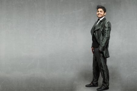 shiny suit: Caucasian man with shiny suit over grey background Stock Photo