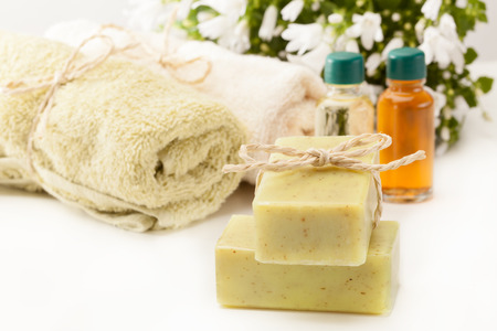 olive green: Photo of olive soap and essential oil