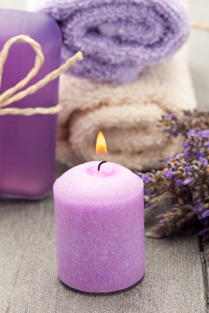 lavande: Photo of candle and lavender soap over wooden table Stock Photo