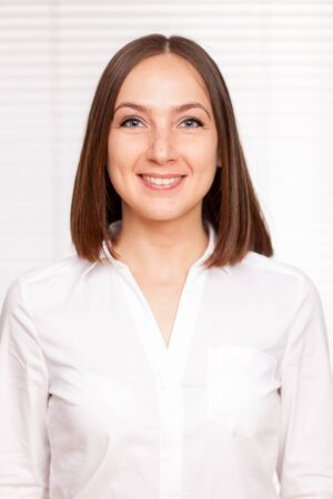 woman white shirt: Portrait of successful brunette businesswoman over white isolated background