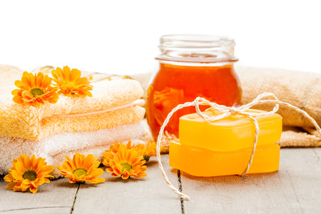 glycerol: Photo of honey soap over wooden table