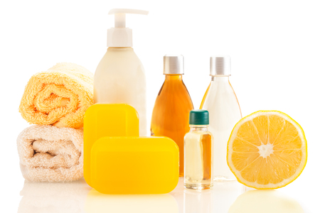 cosmetic product: Photo of spa products with lemon over white isolated background