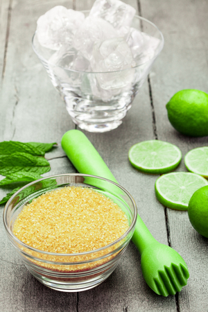 prepare: Photo of ingredients for mojito cocktail over wooden table