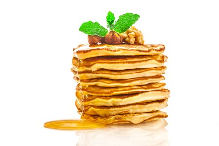 maple syrup: Photo of pancakes with honey over white isolated bachground