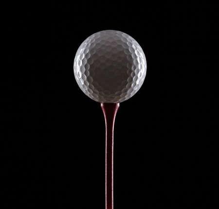 balle de golf: balle de golf sur noir  Banque d'images