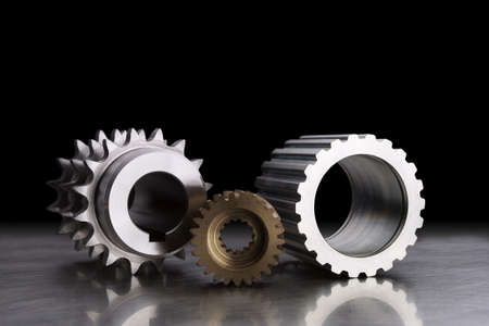 still life of gears on black background