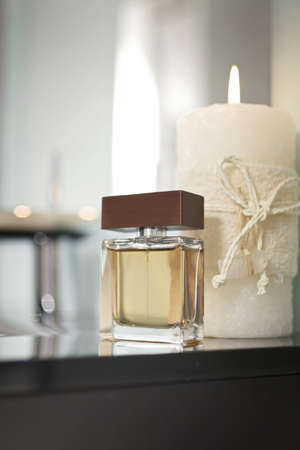 a confection of perfume close to a candle