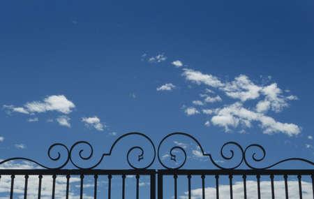 iron gate on light blue sky background
